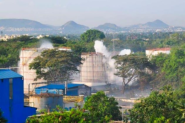 Smokes rise from an LG Polymers plant following a gas leak incident in Visakhapatnam on May 7,