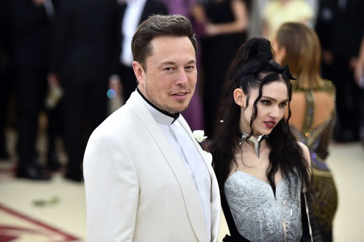 NEW YORK, NY - MAY 07: Elon Musk and Grimes attend the Heavenly Bodies: Fashion & The Catholic Imagination Costume Institute Gala at The Metropolitan Museum of Art on May 7, 2018 in New York City. (Photo by Theo Wargo/Getty Images for Huffington Post)