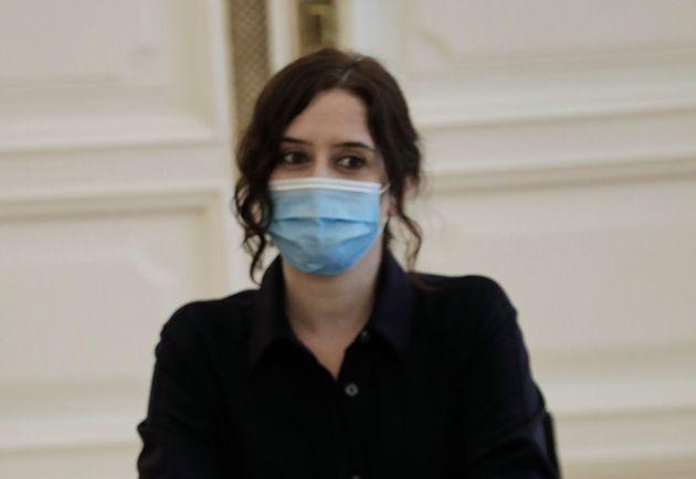 La presidenta de la Comunidad de Madrid, Isabel Díaz Ayuso, en una reunión en la Puerta...