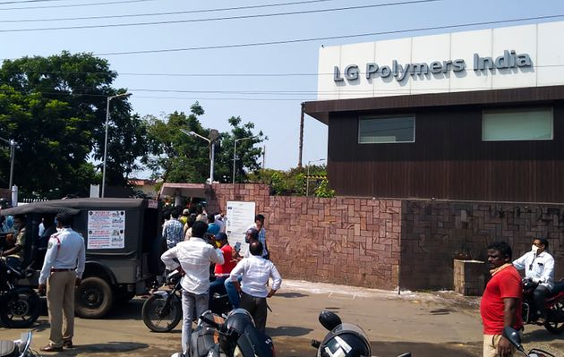 Policemen stand guard as people gather in front of an LG Polymers plant following a gas leak incident...