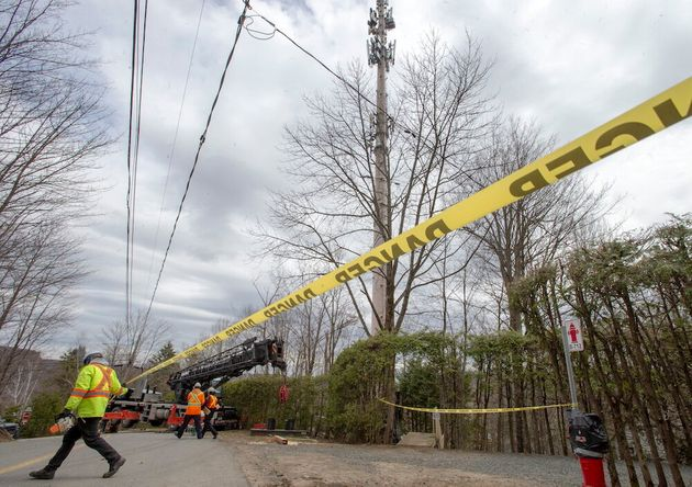 Technicians work on repairing a cellphone tower Monday after a suspicious fire was reported in Piedmont,
