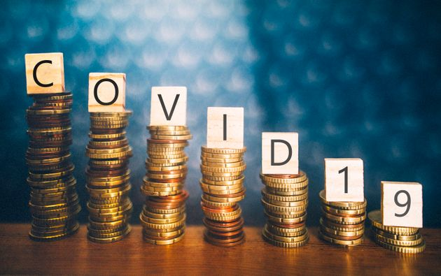 Diminishing stacks of coins with COVID-19 (Coronavirus disease) written on