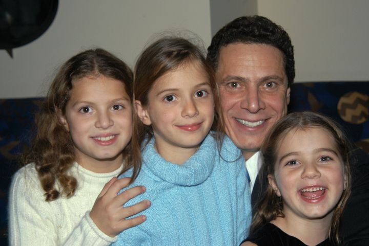 "Cuomo and his kids, Cara, Mariah and Michaela, at the release party for his 2003 book ""Crossroads."""