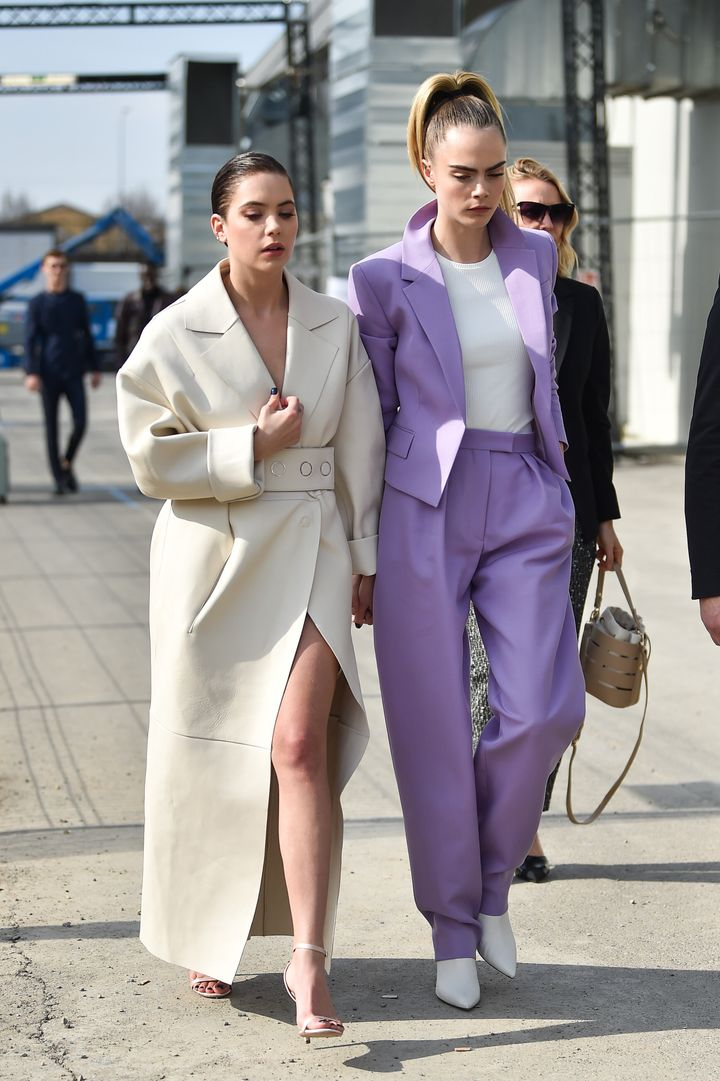 Cara Delevingne Ashley Benson attend the Boss fashion show on Feb. 23 in Milan, Italy.