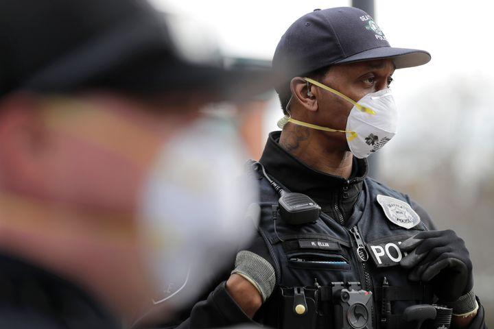 A Seattle police officer wears an N95 mask.