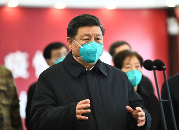 Chinese President Xi Jinping talks through video with patients and medical workers at the Huoshenshan...