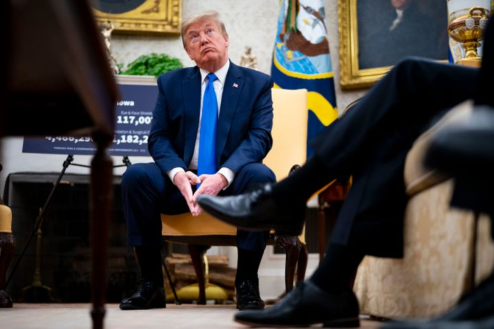President Donald Trump talks to reporters while meeting with Iowa Gov. Kim Reynolds on May 6, 2020. Reynolds lifted some rest