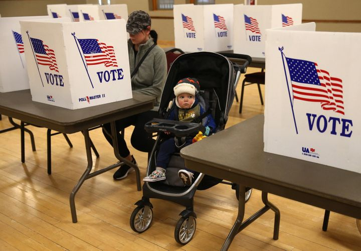 A Missouri mother casts her vote in the state's presidential primary on March 10 in St. Charles, Missouri. The exemptions tha