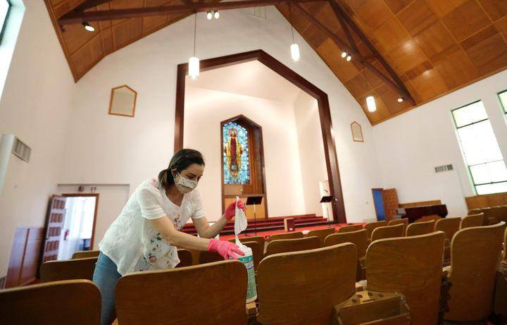 Hannah Contreras helps to clean, sanitize and prepare Alamo Heights Baptist Church for services this Sunday, in San Antonio,