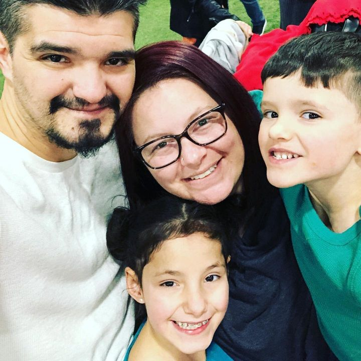 Nadia Barberio is pictured with her children and husband. Barberio says she has no choice but to send her kids back to school, but she is uncomfortable with the guidelines students have to follow.