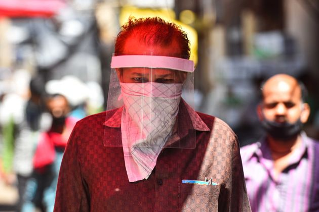 A man seen covering his face with face shield as a precautionary measure from coronavirus at Azadpur...