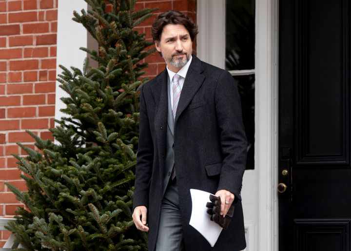 Prime Minister Justin Trudeau steps out of Rideau Cottage for a daily briefing with the media in Ottawa on May 8, 2020.