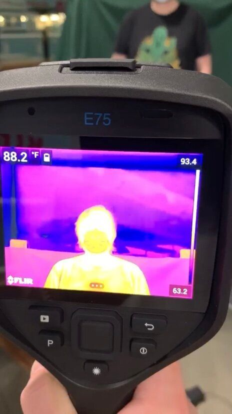 A FLIR thermal imaging camera being used in a Whole Foods store.