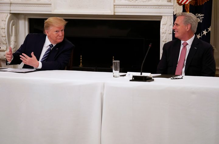 President Donald Trump speaks with House Minority Leader Kevin McCarthy (R-Calif.) during a meeting with Republican lawmakers