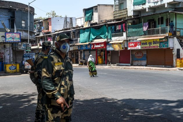 Security personnel from the Border Security Force (BSF) patrol during the lockdown in Ahmedabad on May...