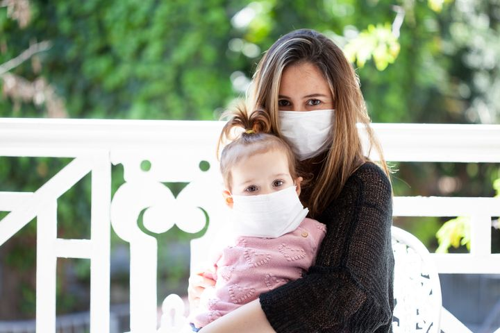 mother and baby wearing a medical mask
