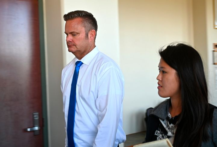 Chad Daybell, Lori Vallow's current husband, walks into court for his wife's hearing on child abandonment and other charges in Hawaii in February. Vallow was later extradited to Idaho.