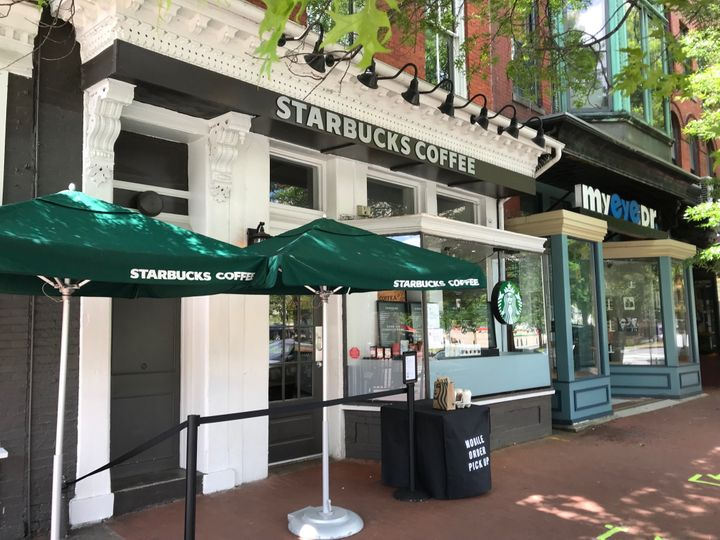A Starbucks in southeast Washington, D.C. where customers can pick up drinks outside. Tape marks off where to stand so people