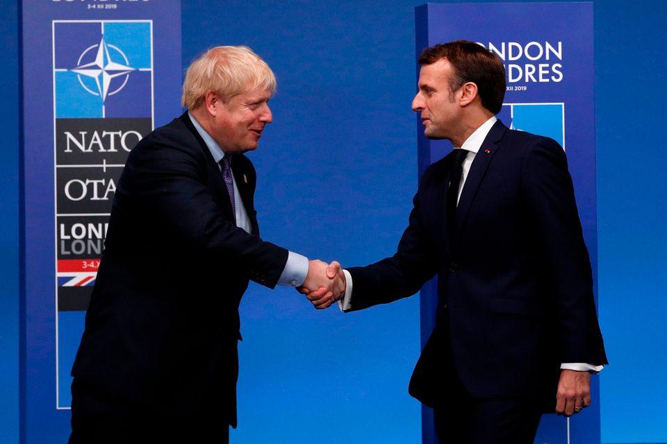 Boris Johnson greets French president Emmanuel