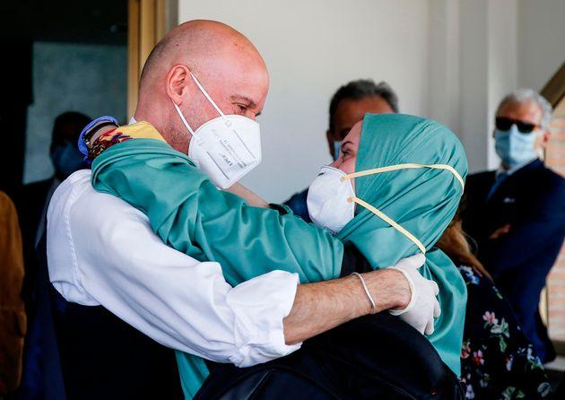 Italian volunteer aid worker Silvia Costanza Romano (R), who was kidnapped in Kenya in late 2018, wearing...