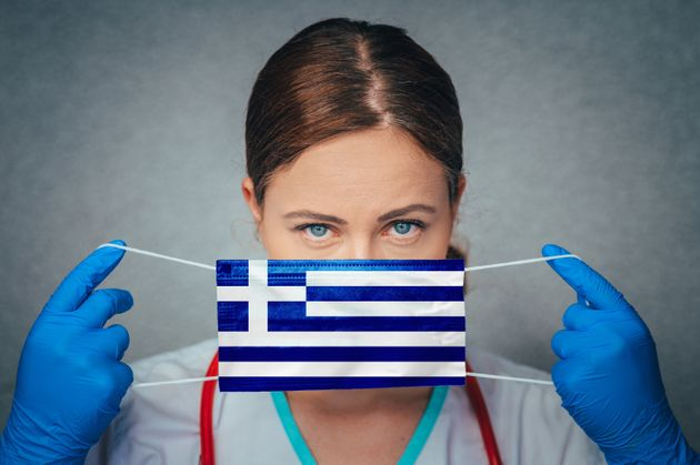 Coronavirus in Greece Female Doctor Portrait hold protect Face surgical medical mask with Greece National...
