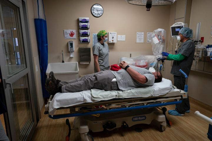 On April 23, medical workers at Kayenta Health Center on the Navajo Nation reservation prepare to practice with a new intubation shield to use when intubating patients.