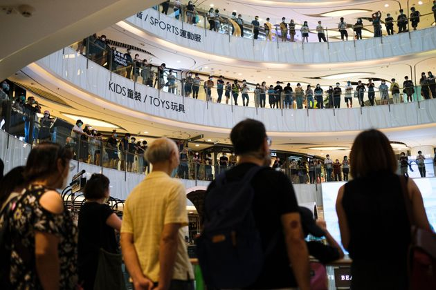 Protesters attend a flash mob gathering in a shopping mall during Mother's