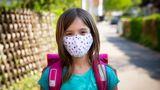Little girl wearing self-made mask