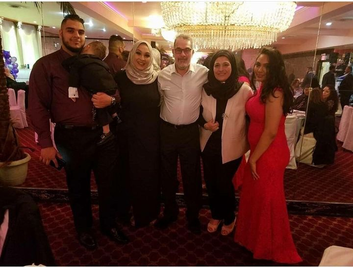 Rami Mohamed, 28, pictured with his parents and sisters.