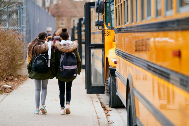 High school students leave Beal Secondary School in London, Ont. on March 13, 2020, the last day of classes...