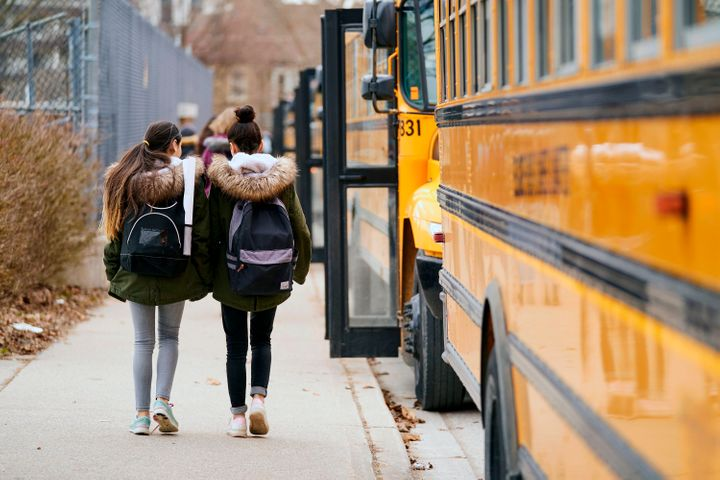 High school students leave Beal Secondary School in London, Ont. on March 13, 2020, the last day of classes before provinces shut down schools to slow the spread of COVID-19.