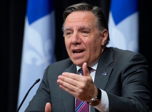Quebec Premier Francois Legault responds to reporters during a news conference on the COVID-19 pandemic...