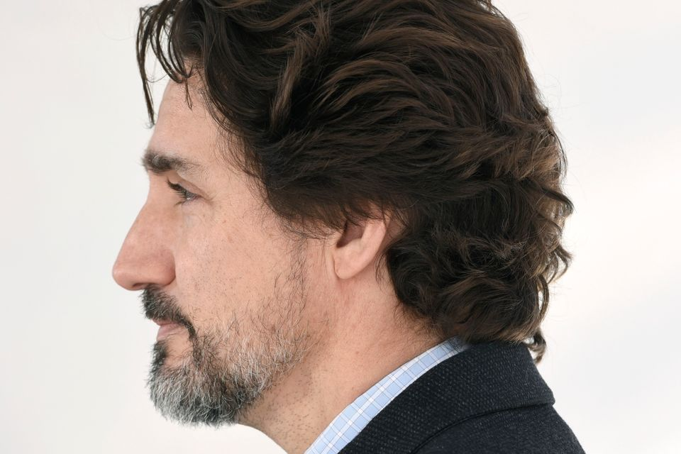 Prime Minister Justin Trudeau listens to a question during his daily news conference on the COVID-19...