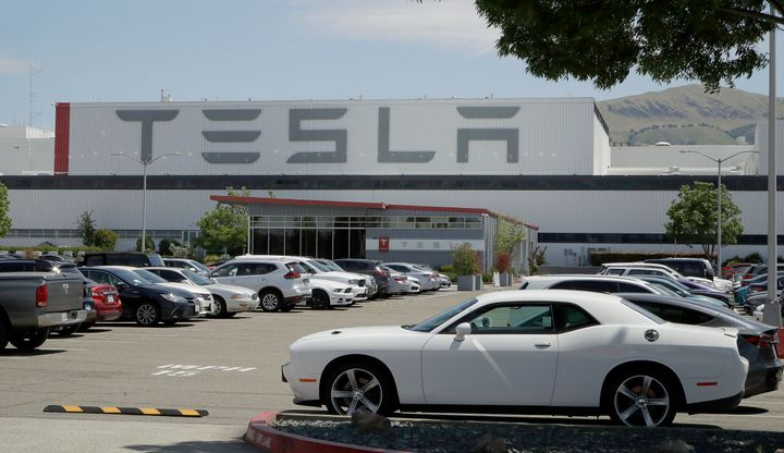 Tesla's Fremont plant in California, with a parking lot full of cars, on May 11, 2020.