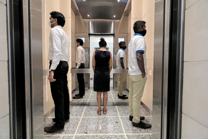 People practice social distancing inside an elevator in Colombo, Sri Lanka, on May 11.
