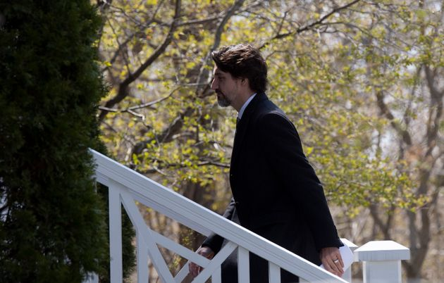 Prime Minister Justin Trudeau walks up the stairs as he returns to Rideau Cottage following a news conference...