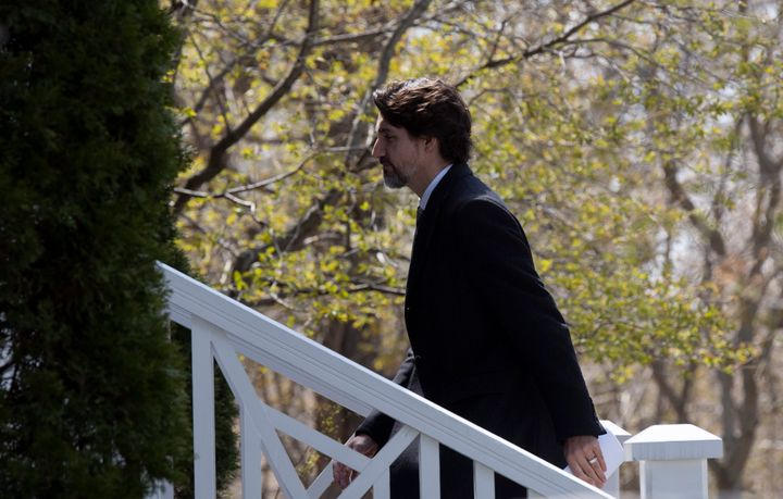 Prime Minister Justin Trudeau walks up the stairs as he returns to Rideau Cottage following a news conference outside Rideau Cottage on May 12, 2020 in Ottawa.