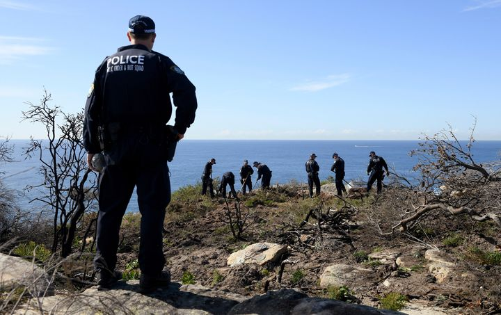 Police search near a cliff in the Sydney area on May 12, following an arrest related to the death of an American man in 1988.
