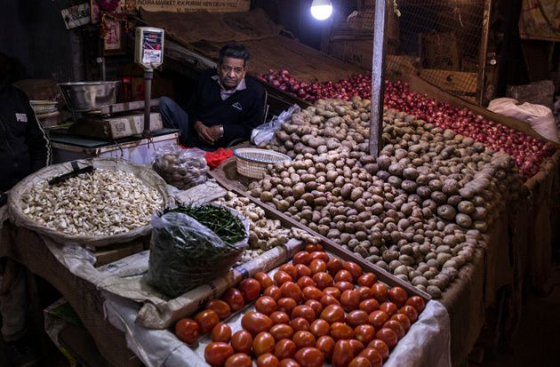 A vendor sells vegetables at a market in New Delhi,