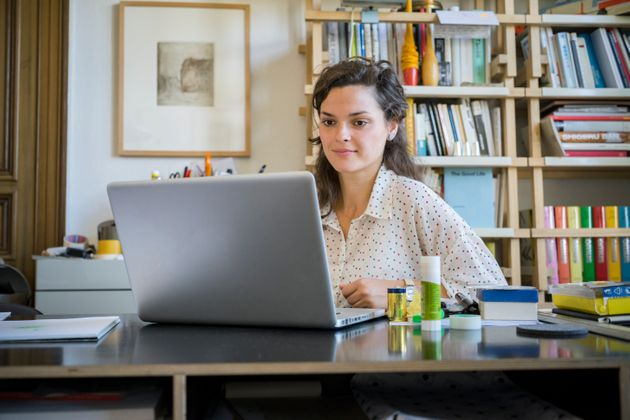 Young businesswoman using laptop at
