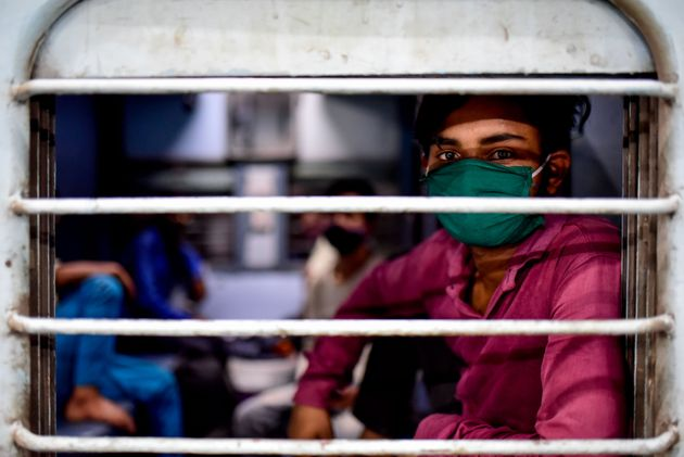 A migrant worker from Uttar Pradesh boards a train at Pune railway station on May 9,