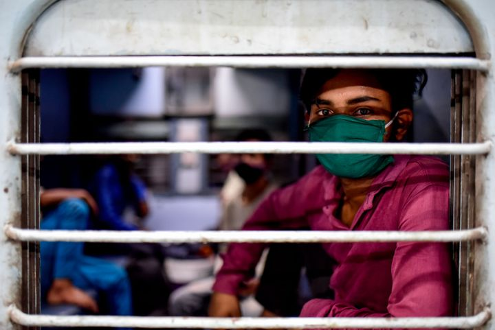 A migrant worker from Uttar Pradesh boards a train at Pune railway station on May 9, 2020.