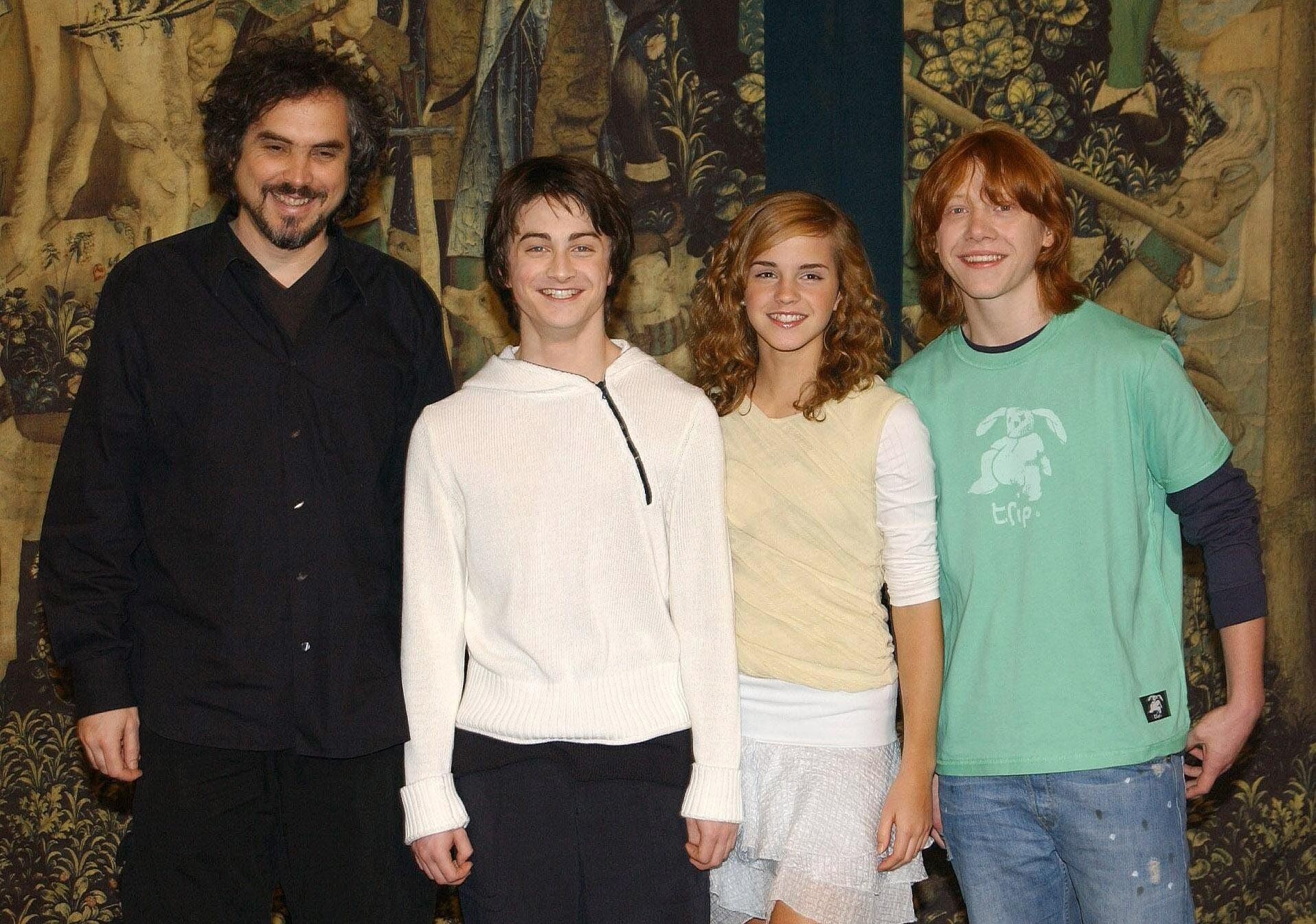 """Alfonso Cuarón, Daniel Radcliffe, Emma Watson and Rupert Grint at the London premiere of """"Harry Potter and the Prisoner of Azkaban,"""" released in 2004."""