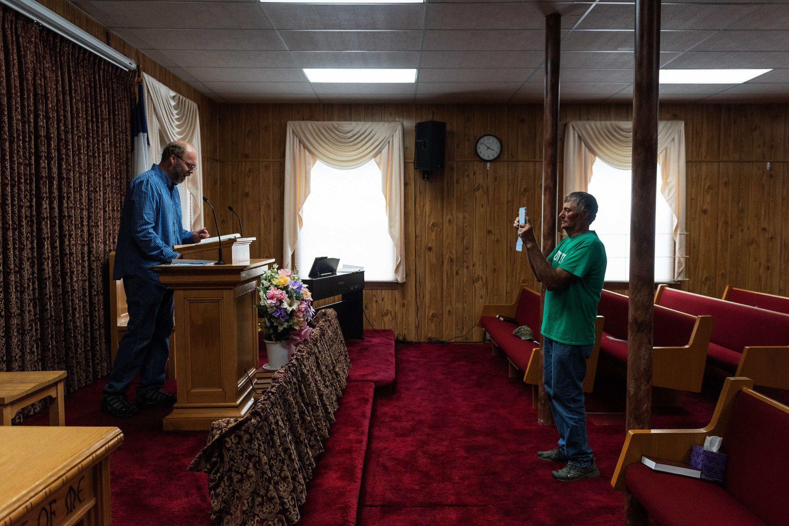 "Tangier Mayor James ""Ooker"" Eskridge records a sermon by Duane Crockett, an elder of New Testament Congregation, inside the c"