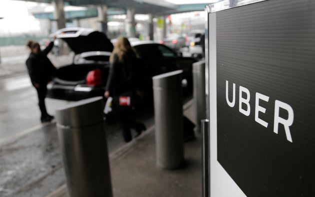 A sign marks a pick up point for the Uber car service at LaGuardia Airport in New York, March 15,