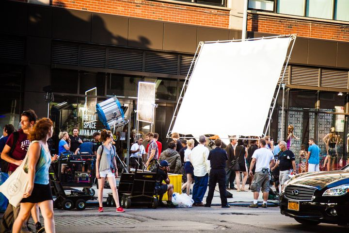 Camera operators and crew members setting up a shot on a street in Chelsea, New York.