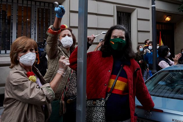 A group of women join a protest in Madrid, Spain, against the government's management of the coronavirus...