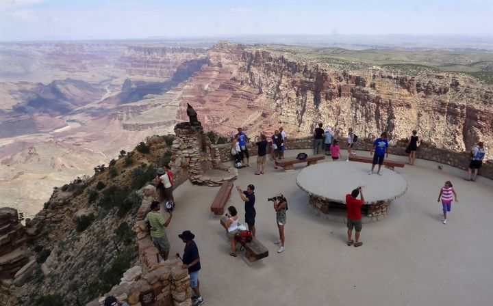 Tourists gather at the South Rim of the Grand Canyon near Tusayan, Arizona, in August 2012.