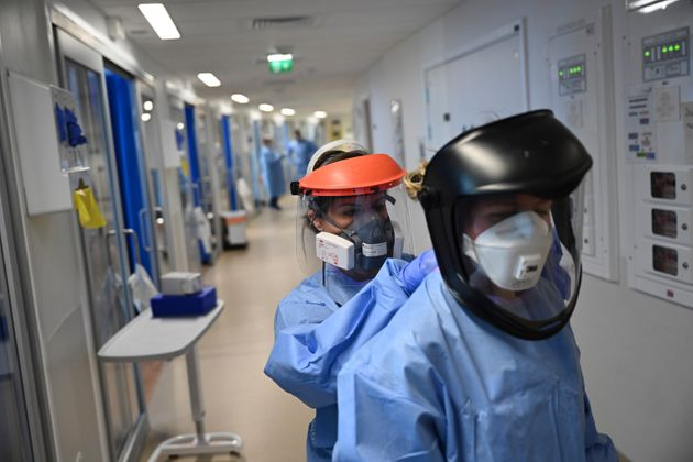Medics wear PPE as they care for patients with coronavirus in the intensive care unit at the Royal Papworth...