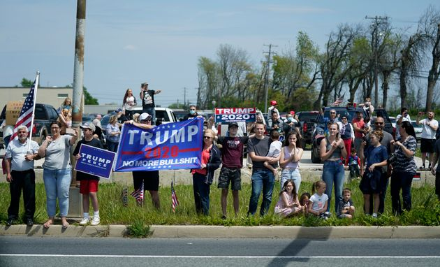 People watch as a motorcade with President Donald Trump drives past on Thursday, May 14, in Allentown,